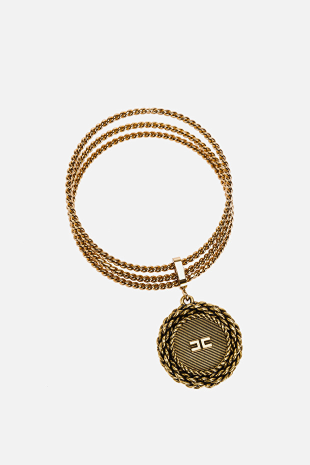 Aged gold torchon bracelet with charm