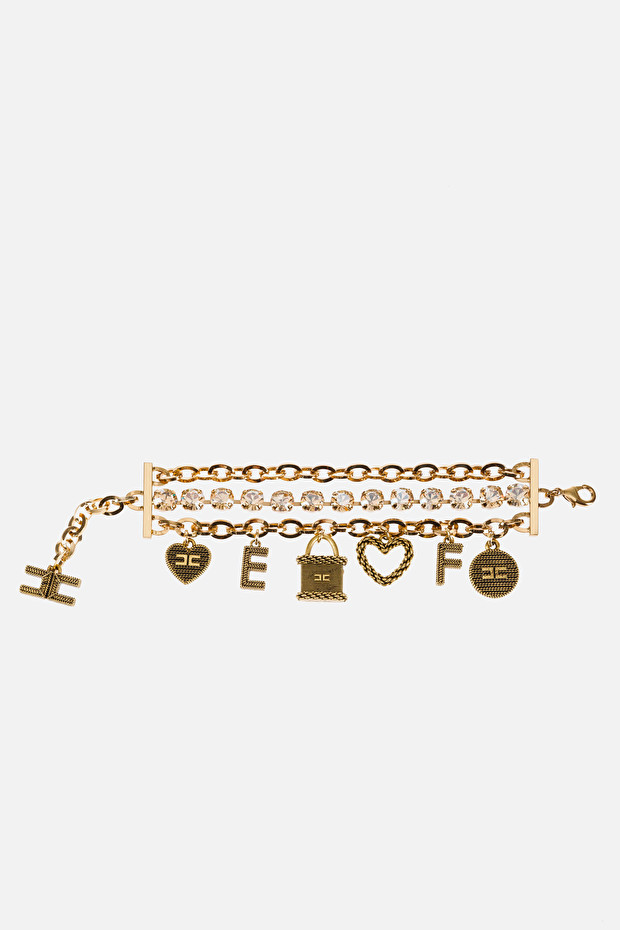 Bracelet in aged gold with charms