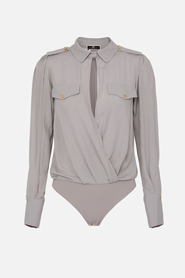 Crossover bodysuit-style blouse with light gold buttons