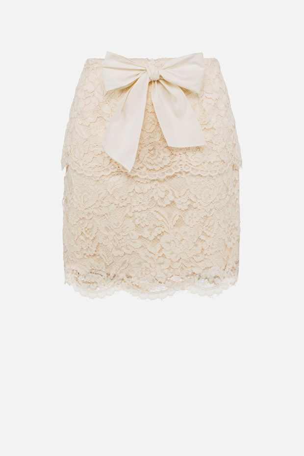 Lace mini skirt with maxi bow
