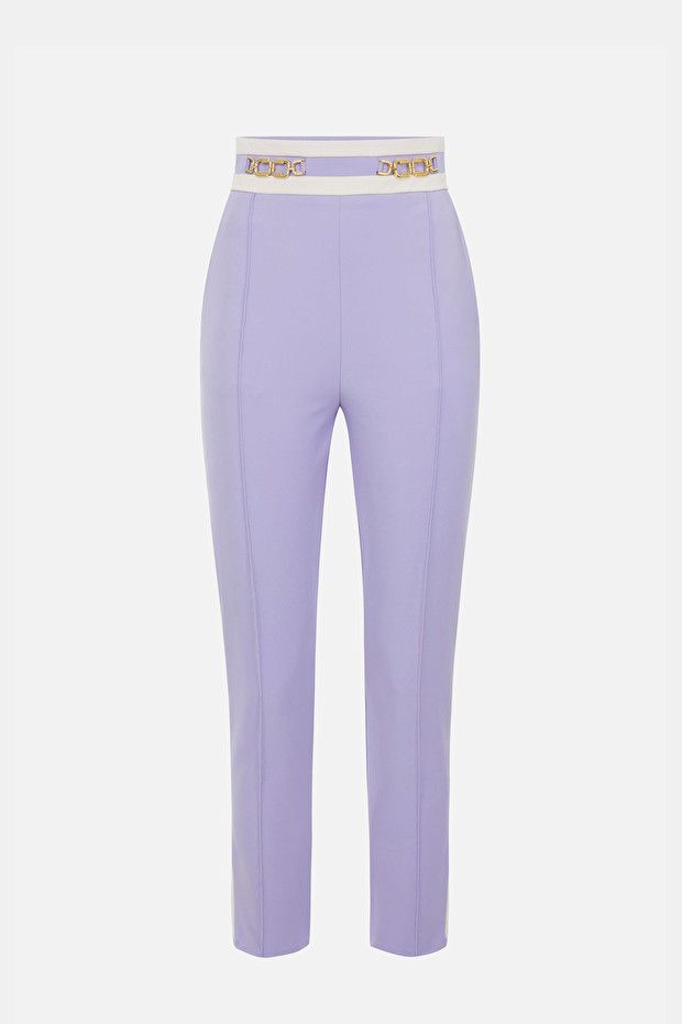 Two-coloured skinny trousers with clasp accessory