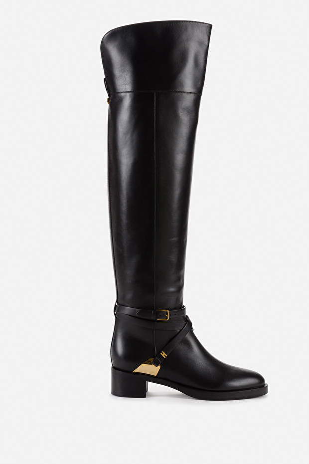 Equestrian style boots with crossover strap