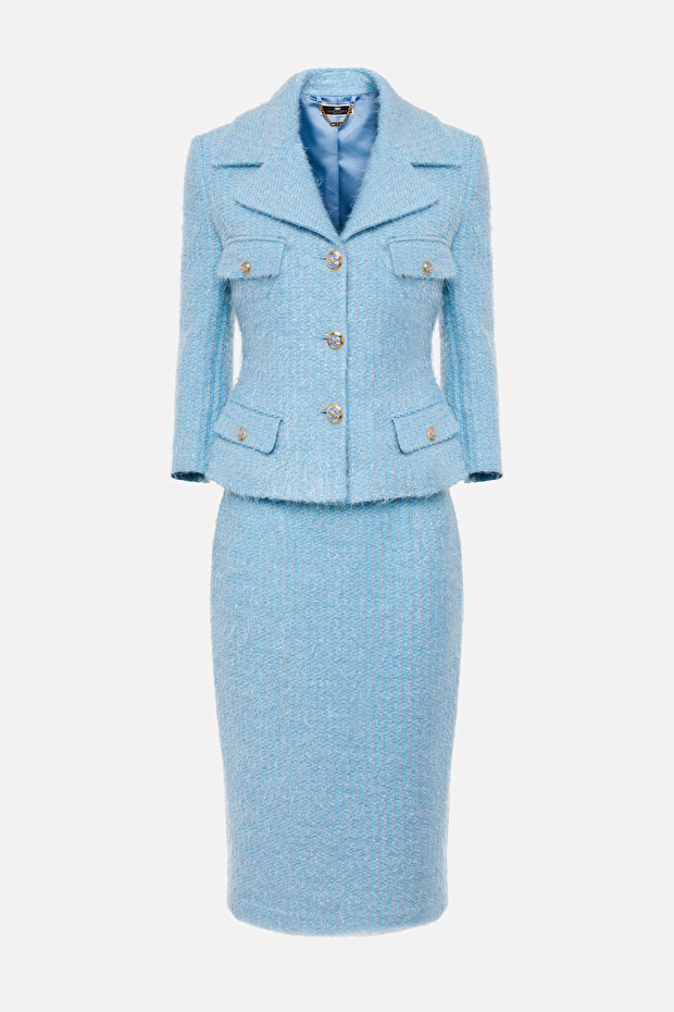 Lady's suit in tweed with jacket and skirt